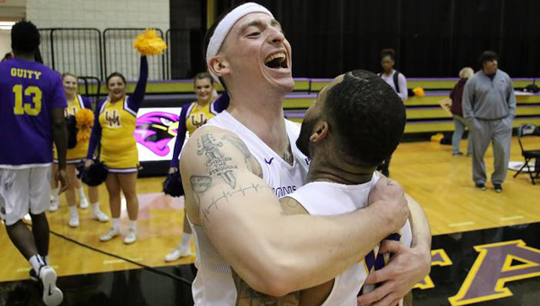 Logan Kelley celebrates with Kevin Kelly after Montevallo came back from down 13 points in the second half to beat Armstrong State in the PBC quarterfinals. (Contributed)