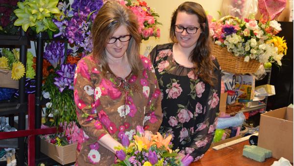 Leelee Gaissert creates an arrangement at The Petal Cart in Pelham, a business she owns with her daughter Kayla Ellis. (Reporter photo/Jessa Pease)