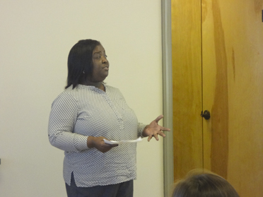 "Gwendolyn Brown, peer advocate at Disability Rights and Resources, speaks to the group about ways to help students with special needs hone their ""soft"" skills at home. (Reporter Photo/Emily Sparacino)"