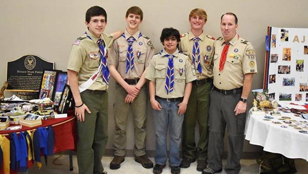 Eagle Scouts Owen Barnes, Ryan Harmon, Josh Davis and A.J. Cole with Troop 560 Scoutmaster David Davis. Barnes, Harmon and Cole advanced to the rank of Eagle Scout at a ceremony on April 10. (Contributed)