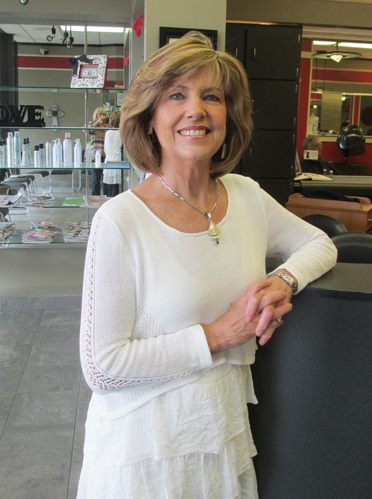 After going to cosmetology school at age 55, Beth Davis opened Hairway to Heaven in 2012. (Contributed)