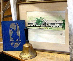 "This 1949 Pelham Echoes yearbook along with a school bell were donated by John Ward Hinds of Spanish Fort to the Kenneth R. Penhale City of Helena Museum. Also on display is a watercolor entitled ""School Days at Pelham 1940-1965,"" signed Conger. (Contributed)"