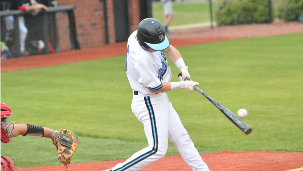 Jacob Rich puts a ball in play during Spain Park's 8-1 loss to Hewitt-Trussville on April 19. (Reporter Photo / Baker Ellis)