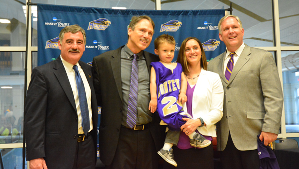 New Montevallo head women's basketball coach Gary Van Atta, center left, with son Kade and wife Courtney, are bookended by Montevallo president Dr. John Stewart, far left, and athletic director Mark Richard, far right, on April 20 during a press conference announcing Van Atta as the new head coach. (Reporter Photo / Baker Ellis)