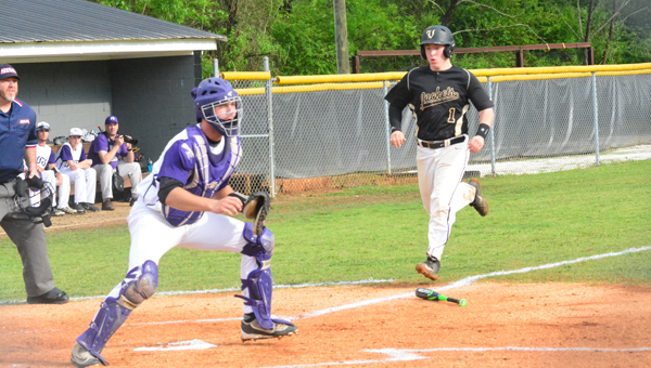 Matthew Swift scores Vincent's first run against Ranburne in the first game of the Yellow Jacket's opening round playoff series. Vincent beat Ranburne two games to one to advance in the 2A playoffs. (Reporter Photo / Baker Ellis)
