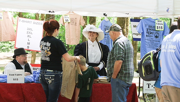 Visitors of Helena Founder's Day shop for T-shirts as the Second Annual Helena Founder's Day was held Saturday, April 23 at the Helena Amphitheater. (For the Reporter/Dawn Harrison)