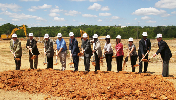Mayor Gary Waters and members of the Pelham City Council and Board of Education toss dirt with their shovels to celebrate breaking ground on Pelham Park Middle School (For the Reporter/Eric Starling)