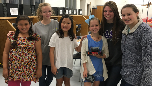 Oak Mountain Middle and Elementary school students worked together to build and program robots. (Contributed)