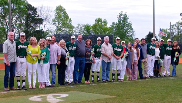 Seniors on Pelham High School's baseball team celebrate with their parents on Senior Night March 15. (Contributed)