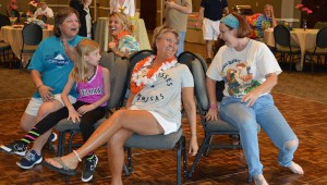 Attendees of the city's Parrot and Fin Party participate in various games at the event, such as musical chairs.