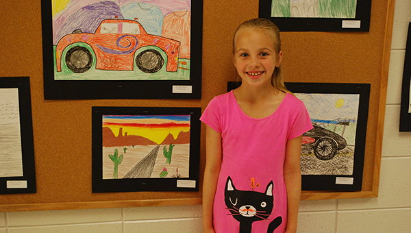 Helena Intermediate third grader Sarah Bradford shows off her crayon portrait at the HIS art show on April 19. (Reporter Photo/Graham Brooks)