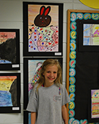 Helena Intermediate fourth grader Hannah Bradford poses with her crayon and marker project at the HIS art show. (Reporter Photo/Graham Brooks)