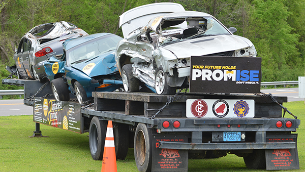 A tractor trailer with wrecked cars due to distracted and buzzed driving sits outside of Helena High School to remind students of the possible consequences they may face if they drink and drive. (Reporter Photo/Graham Brooks)