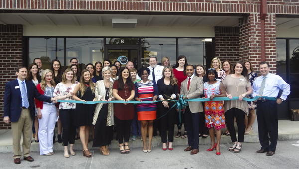 Dr. Corey Hartman and his staff join South Shelby Chamber of Commerce members in celebrating the grand opening of the Skin Wellness Center of Alabama's new Chelsea branch with a ribbon cutting April 21. (Reporter Photo/Emily Sparacino)