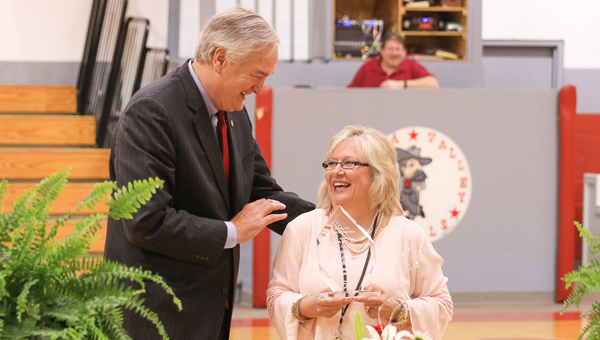 Alabama Attorney General Luther Strange presents Coosa Valley Academy Headmaster Pamela Lovelady with an award for the safety measures at Coosa Valley Academy on April 21. (For the Reporter/Dawn Harrison)