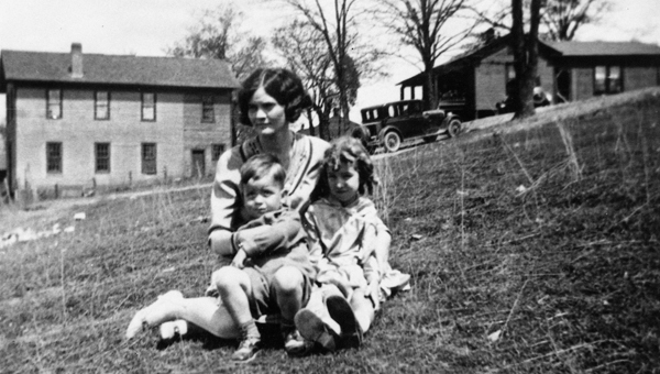 Early Spring Outing, 1929. Sue Braden, a teacher at the Helena School, Sara Nelson and Bill Tucker enjoyed a pleasant afternoon in the spring of 1929. The original Masonic Lodge can be seen in the left rear. The house in the right rear was the home of the Jim Wooten family. (Contributed/City of Helena Museum)