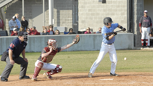 Helena's Robbie Lively (5) lays down a bunt in game one of the third round playoff series against Faith Academy on Friday, May 6. (Reporter Photo/Graham Brooks)