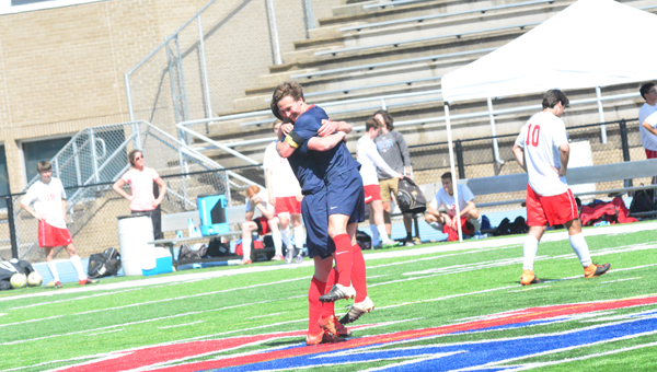 Oak Mountain's Landon White embraces teammate Christian Thomason at midfield on May 7 after the Eagles knocked off Vestavia Hills 1-0, punching their ticket to the Final Four for the sixth year in a row. (Reporter Photo / Baker Ellis)