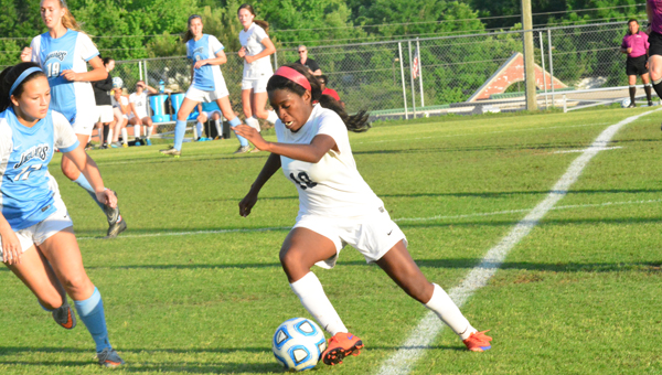 Oak Mountain's Hailey Whitaker maneuvers around Spain Park's Lauren Laney during the Lady Eagles 2-1 win in the opening round of the 7A playoffs on May 3. (Reporter Photo / Baker Ellis)