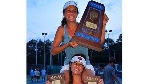 Sisters Frannie Ware (bottom) and Callie Ware smile and show off their hardware after winning the 6A No. 4 and No. 2 court singles titles, respectively, on April 29. (Contributed)