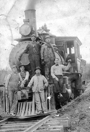 Roebuck Mines. The railroad was an integral part of a successful mining operation. This photo of a switching engine was taken at the Eureka Mines sometime before 1920. This locomotive would have taken the coal from the mines to the Louisville & Nashville yard in Helena. Fred Draper, who worked at the mines, can be seen in the far left. (Contributed/City of Helena Museum)