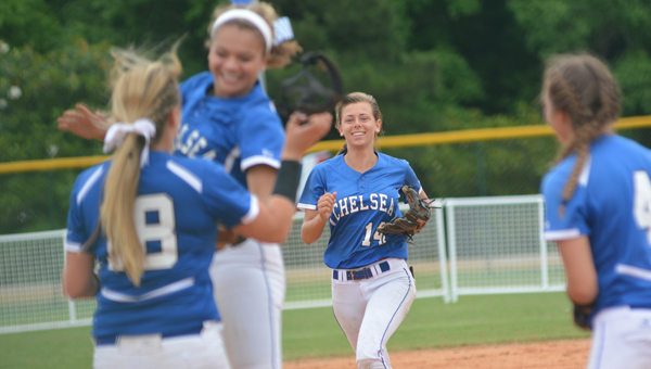 McKenzie Bryant and the Chelsea Lady Hornets celebrate after beating Oxford for the first time on May 20. Chelsea beat the Lady Yellow Jackets twice on May 20 en route to claiming the 6A state softball title. (Reporter Photo / Baker Ellis)