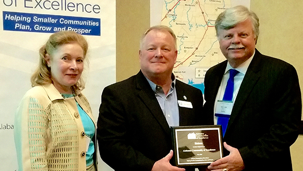 From left, ACE executive director Sidney Hoover and Alabama League of Municipalities executive director Ken Smith present Helena Mayor Mark Hall with Helena's ACE award on May 14. (Contributed)