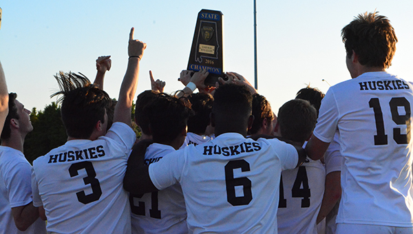 The Helena Huskies boys soccer team celebrates and lifts the state championship trophy after defeating Randolph 4-0 on Friday, May 13 to capture the program's first state title. (Reporter Photo/Graham Brooks)