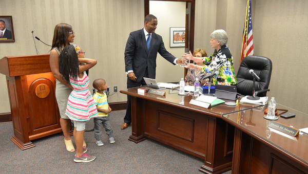 Hoover Board of Education President Derrick Murphy is recognized for his service to the school system by Hoover City Schools Superintendent Dr. Kathy Murphy during a May 9 meeting. (Contributed)