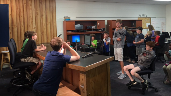 OMES and OMMS students collaborate to create a news broadcast. (Contributed)
