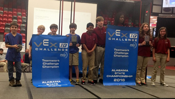 The OMMS robotics team took top honors at the Alabama TSA State Conference IQ tournament and will travel to nationals in June. Pictured are members of the OMMS team at a tournament earlier this year. (Contributed)