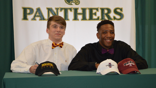 Pelham High School's Dillon Turner and Hasaan Hawthorne commit to wrestle for Emmanuel College and North Idaho College, respectively. (Reporter photo/Jessa Pease)