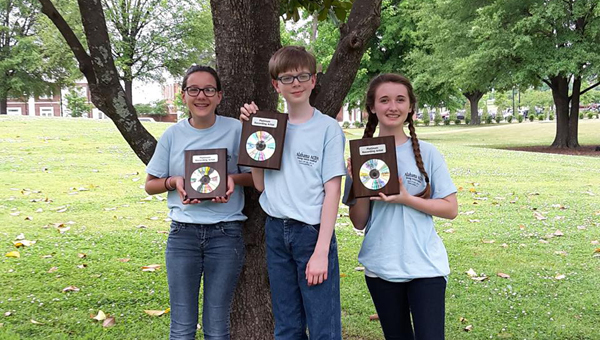 Shelby Kendall, Jonathan Wiedeburg and Dorothy Willman participated in the Alabama American Choral Director's Association Young Voices Festival in Tuscaloosa. (Contributed)