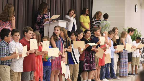 Fifth-grade students at Forest Oaks Elementary School receive special awards for their work at an end-of-year ceremony May 13. (For the Reporter/Dawn Harrison)