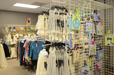 Children's clothing and decorations are among new items available from vendors in the upstairs portion of Some Wear in Time Consignment Boutique in Chelsea. (Reporter Photo/Emily Sparacino)