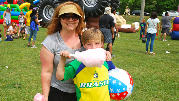 Amanda and Jackson Reagan enjoy this year's Celebrate Hoover Day at Veterans Park on Valleydale Road on April 30. (Reporter Photo/Molly Davidson)