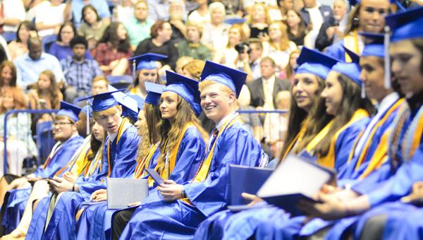 Chelsea High School seniors hold their diplomas at graduation May 24 at Samford University's Pete Hanna Center. (Reporter Photo/Emily Sparacino)