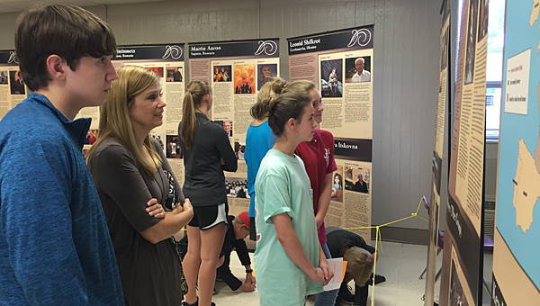 Students and parents view a traveling Holocaust exhibit at Thompson Sixth Grade Center on the night of April 28. (Contributed)