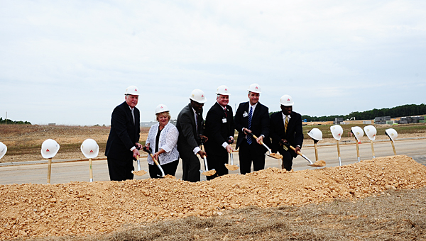 Alabaster School Board members hold a ceremonial groundbreaking ceremony at the site of the city's upcoming new high school on May 16. (Reporter Photo/Neal Wagner)
