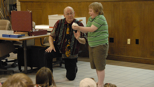Last year, a magician wowed a participant at Helena's Summer Reading Program. This year, the program kicks off on Wednesday, June 8. (File)