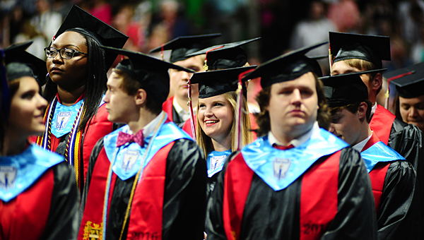 A THS senior smiles after joining her classmates during the school's graduation ceremony on May 24 at Bartow Arena. (Reporter Photo/Neal Wagner)