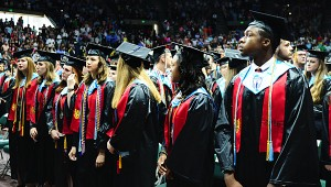 Thompson High School's valedictorians prepare to take their seats during the ceremony. (Reporter Photo/Neal Wagner)