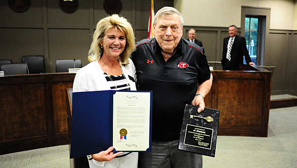 Alabaster Mayor Marty Handlon, left, presents a proclamation and a key to the city to longtime Thompson High School athletic supporter J.C. Whitfield. (Reporter Photo/Neal Wagner)