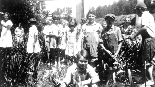 Cahaba Lilies. This May 1934 photo captures a Helena Baptist Church outing at the lilies in Buck Creek. Note the young man holding an arrangement of lilies in his hand. This would certainly be frowned upon today. Mrs. Emmie Davidson can be seen in the right rear. (Contributed/City of Helena Museum)