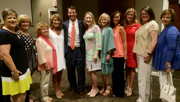 Vignette Club members Pam Oliver, Phyllis French, Dolores Jones, Carol Hill, Elizabeth Shelton, Edna Sealy, Elizabeth Smith, Jennifer Maier and Linda Major pose with Miss Shelby County Hayley Barber and Clemson Head Coach Dabo Swinney at the Making Miracles Luncheon on May 16. (Contributed)