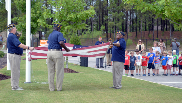 The first official flag team of the American Legion Matthew Blount Post 555 performs a retirement ceremony for Covenant Classic School and Daycare's aged American flag June 14. (Reporter photo/Jessa Pease)
