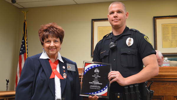 Officer Carl Perkinson receives the Enrique Camarena Award for his work with drug abuse programs from the Cahaba Valley Elks. (Reporter photo/Jessa Pease)