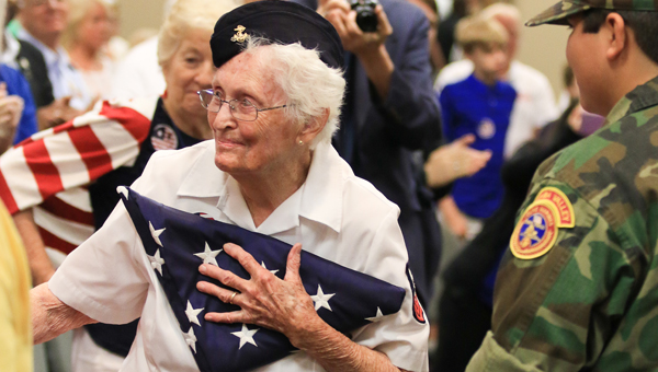 After an explanation of the Thirteen Folds of the American flag, the flag was presented to a former military mechanic, who is now nearly 100 years old. (For the Reporter/Dawn Harrison)
