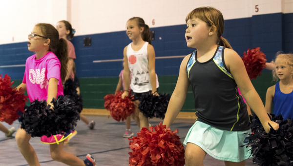 Girls practice a routine at Oak Mountain Elementary School's summer cheer camp June 2. (Reporter Photo/Keith McCoy)