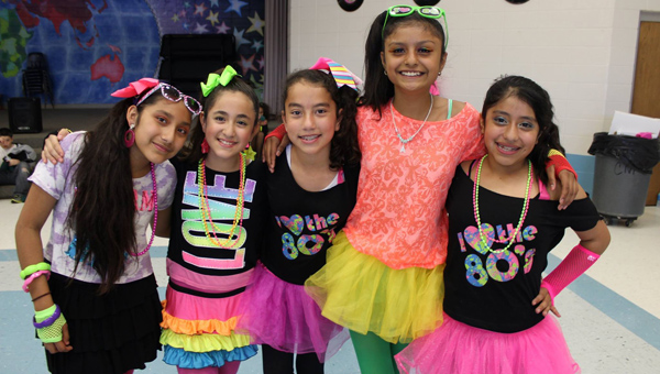 Valley Intermediate's fifth-grade dance allowed students to deck out in decade attire ranging from the '50s to '90s. (Contributed)